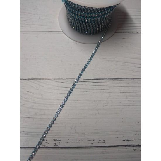 Стразы цепочкой (разм.SS6) цв. белый кристалл в голубой оправе, цена за 50 см